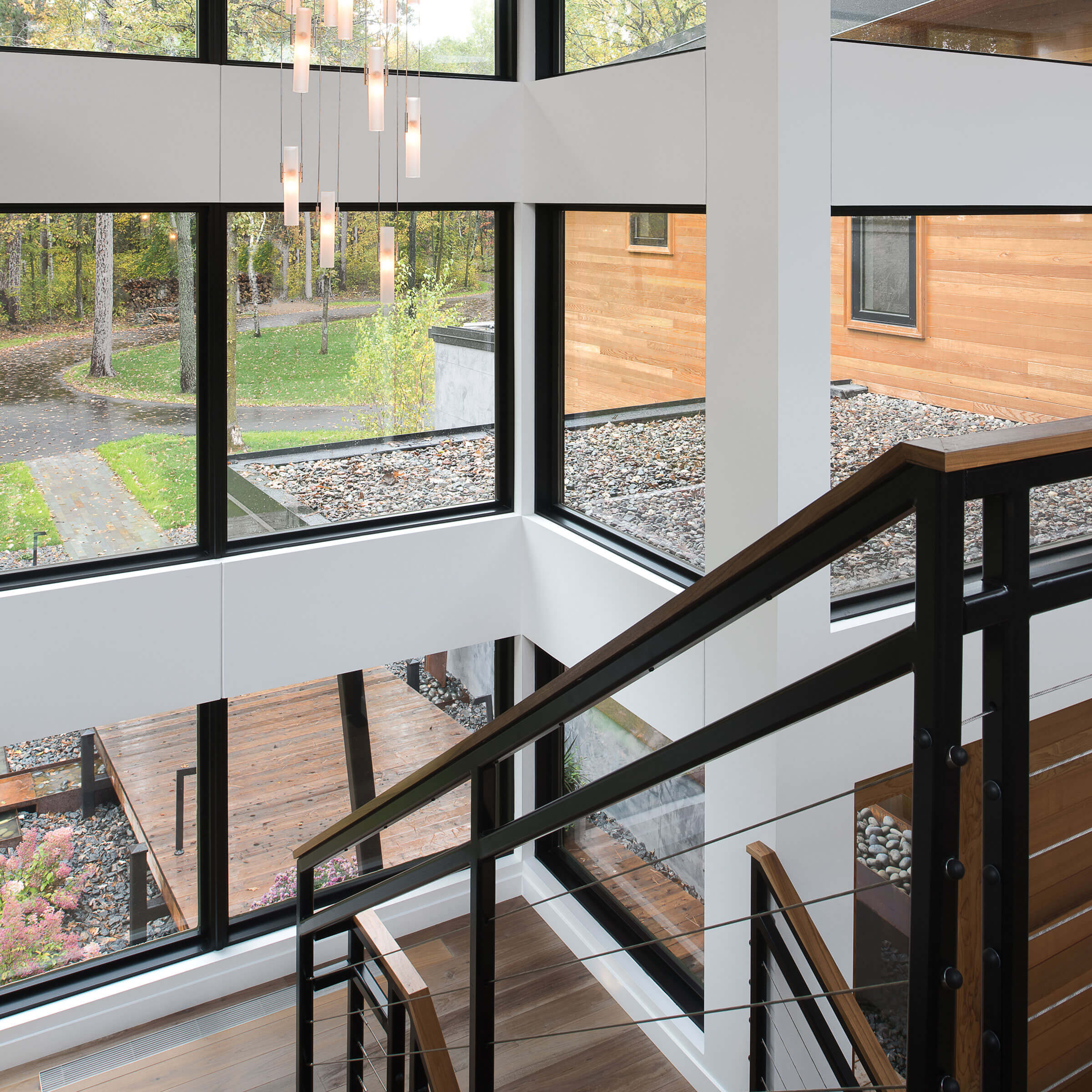 Large Stairwell Surrounded By Signature Ultimate Picture Narrow Frame Windows