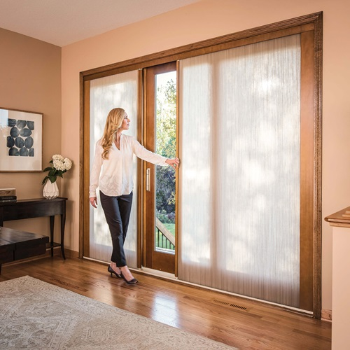 Woman Opening Signature Ultimate Sliding French Door With Shades
