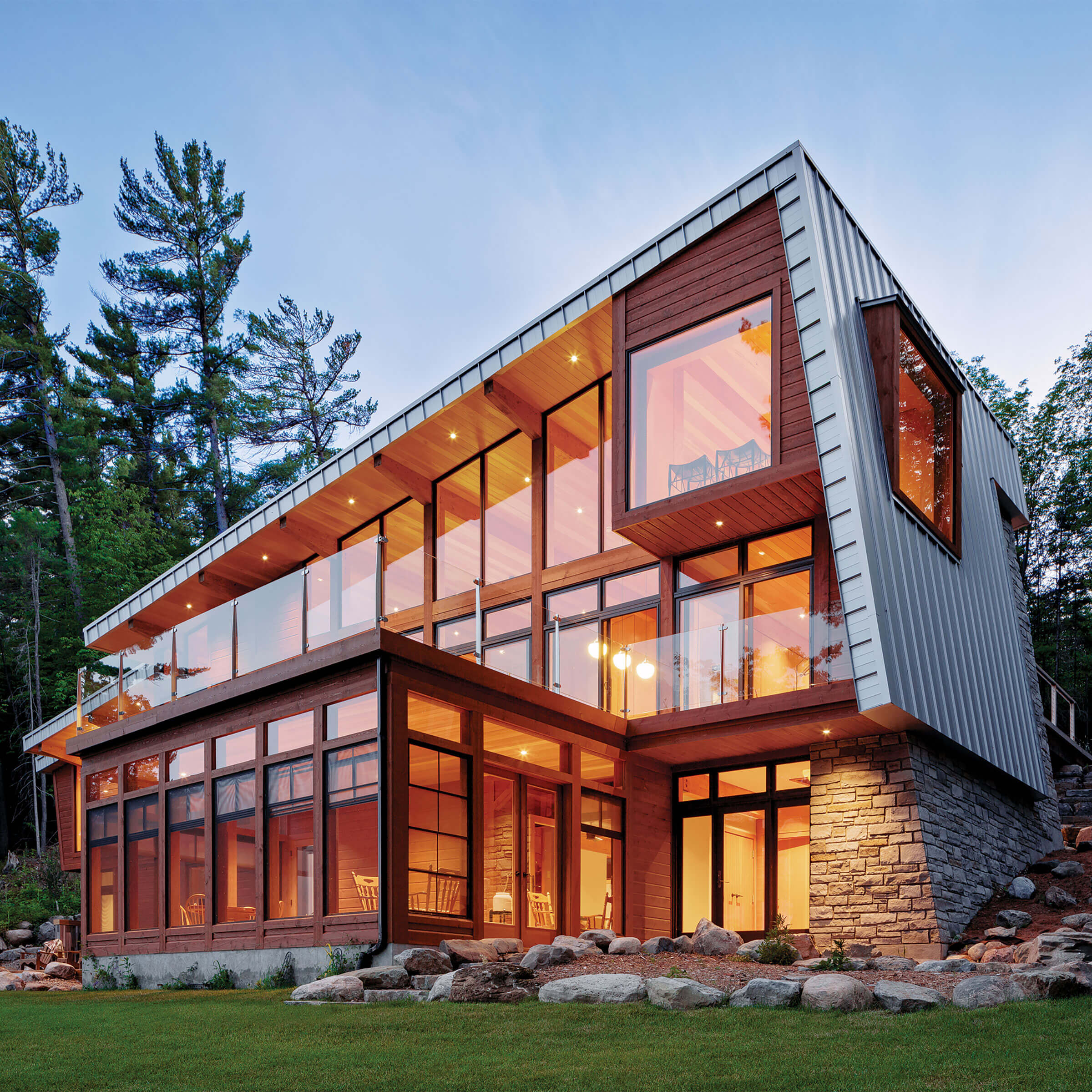Exterior View Of Brightly Lit House With Signature Ultimate Specialty Shapes Windows