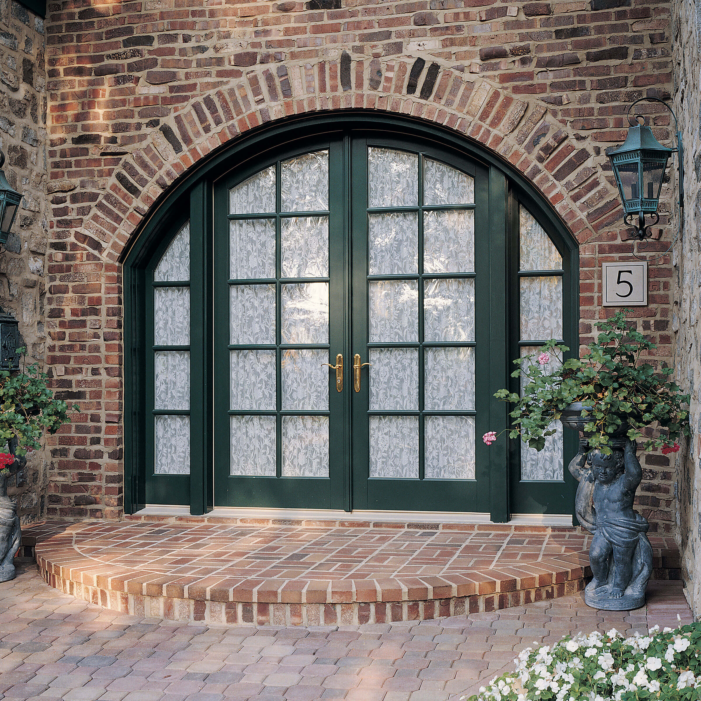 Beautiful Stone-Faced Entrance Of House With Signature Ultimate Swinging Arch Top French Door