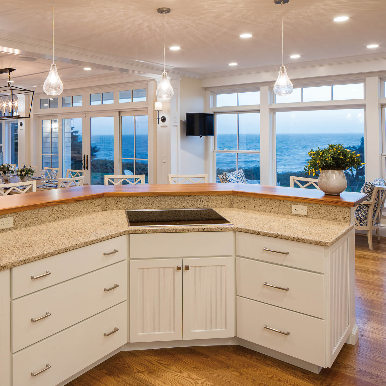 Kitchen view of waterfront home with Marvin Elevate Double Hung Windows and Elevate Sliding French Door