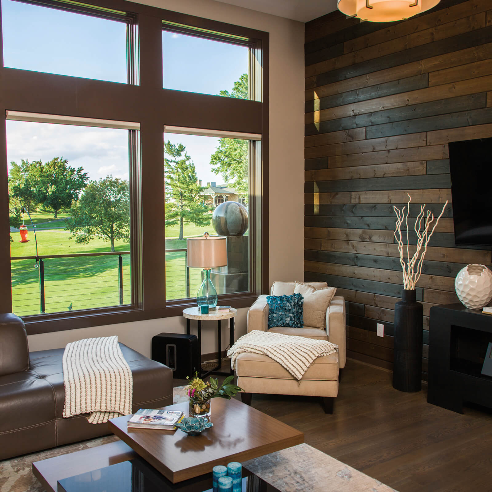 Modern style living room with wood paneling that features Marvin Elevate Picture Windows