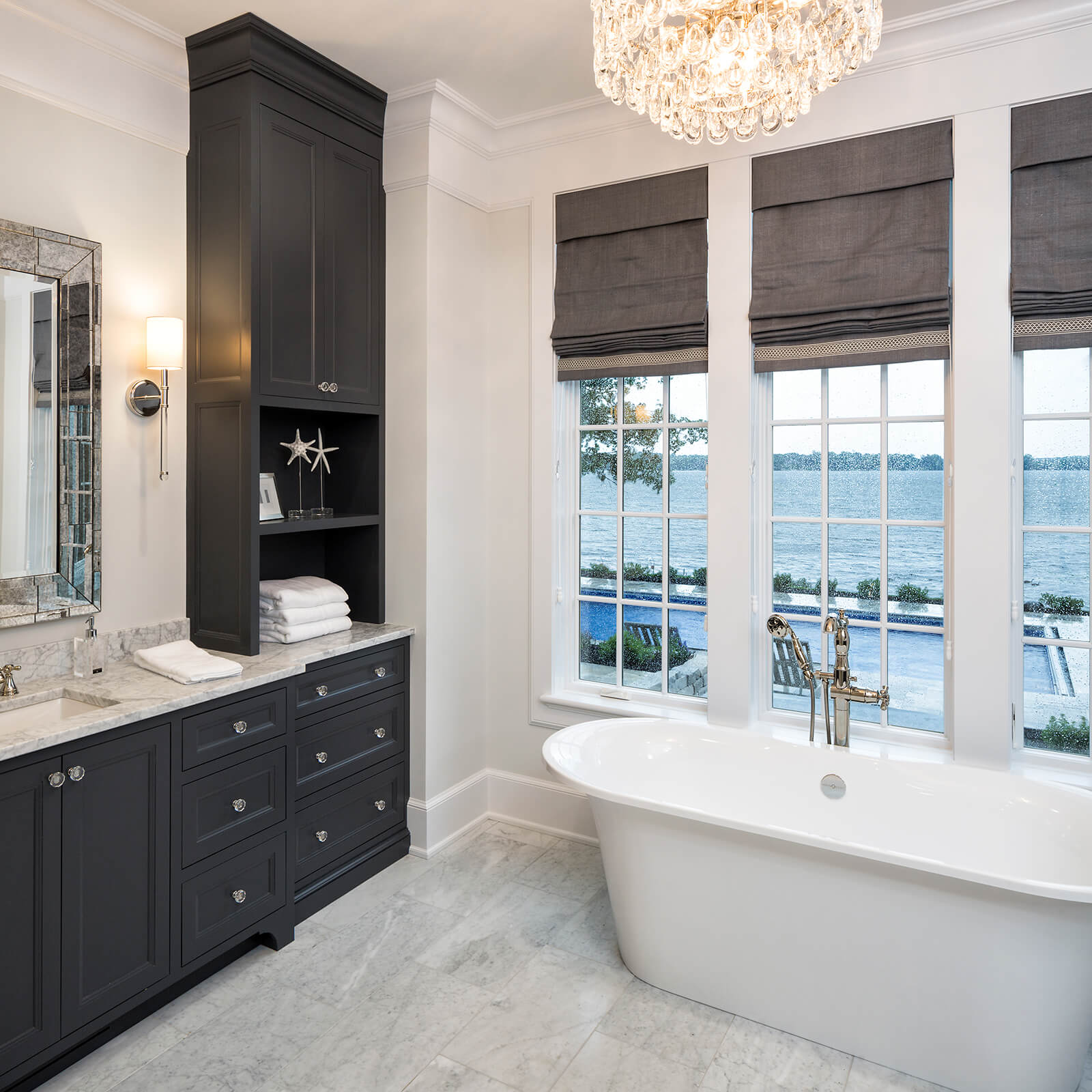 Modern style bathroom with pool and lake view with Marvin Elevate Casement Windows