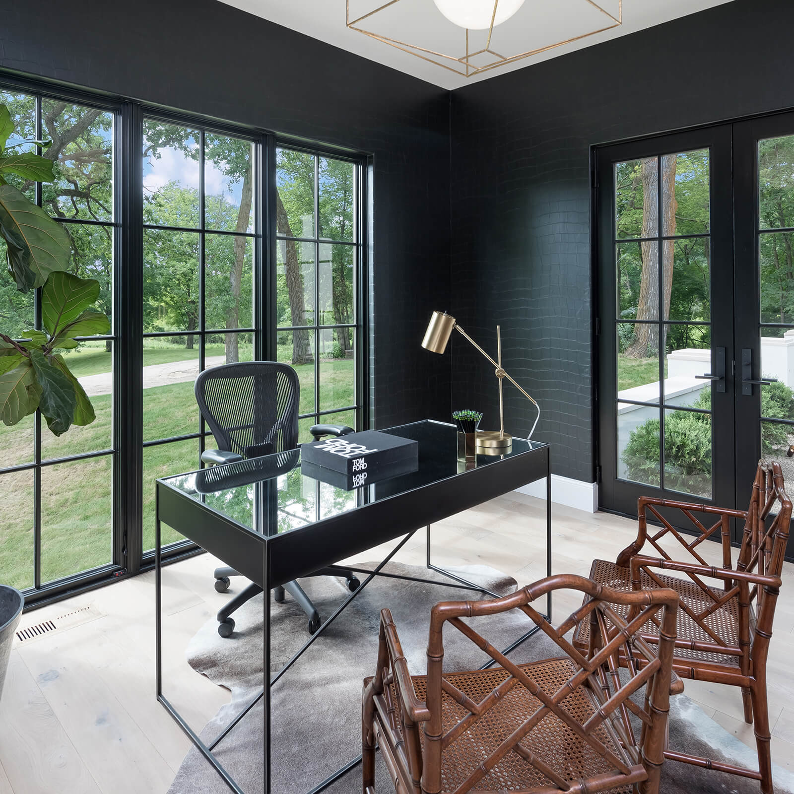 Modern office area with multiple Marvin Signature Ultimate Casement Windows and Inswing French Door