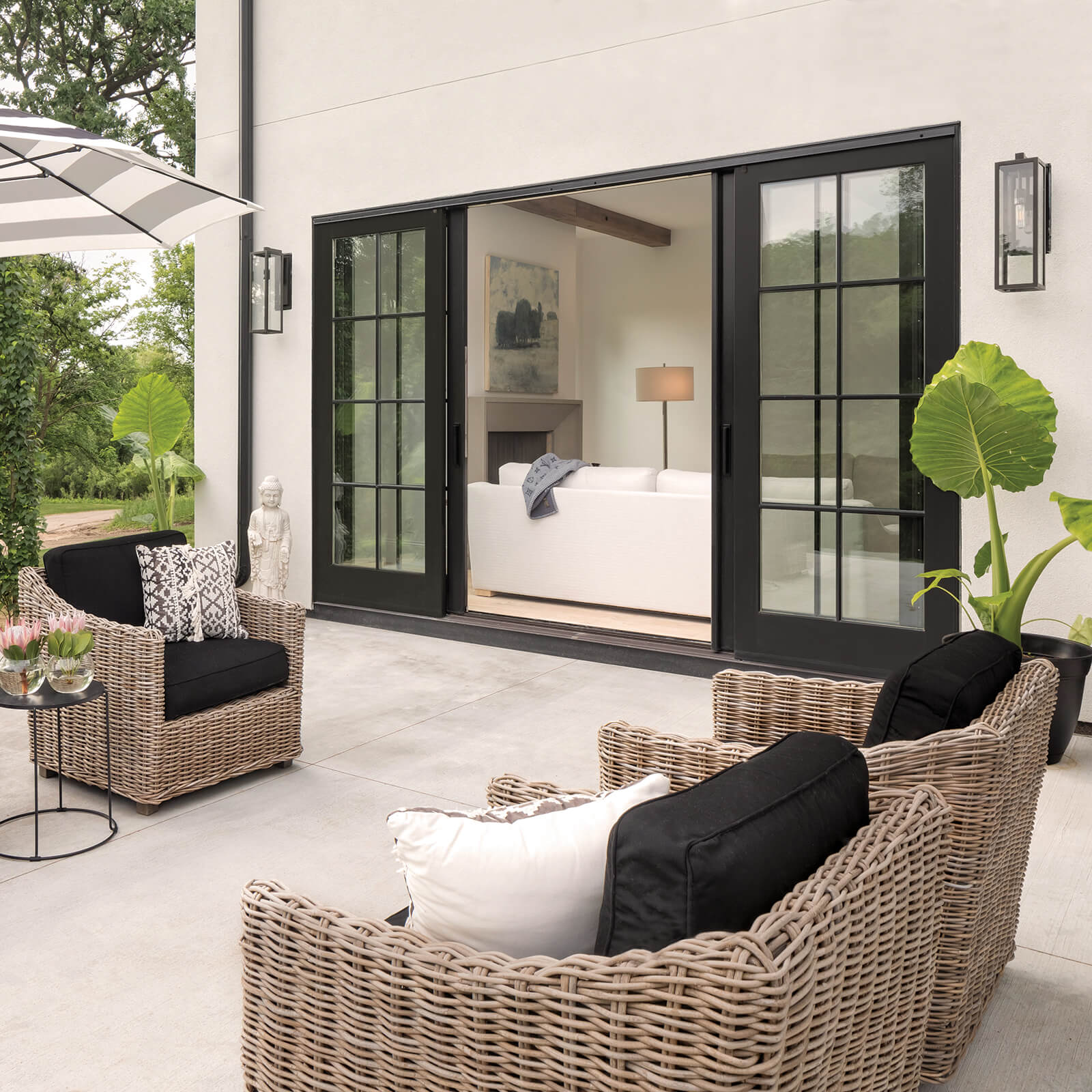 Patio entertainment area with open Marvin Signature Ultimate Sliding French Door