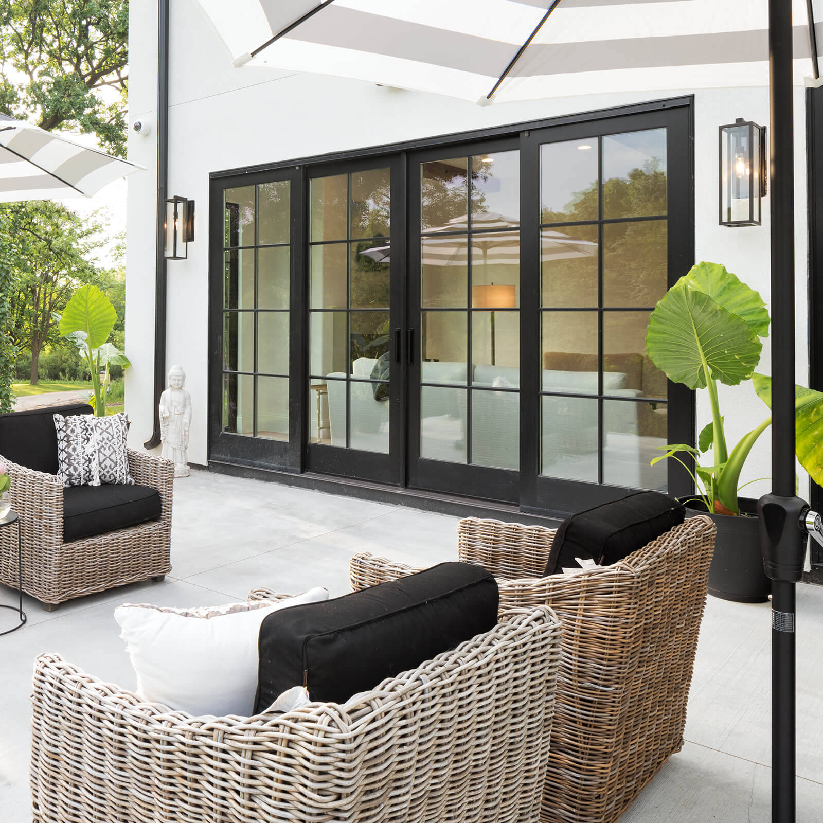 Patio entertainment area with closed Marvin Signature Ultimate Sliding French Door