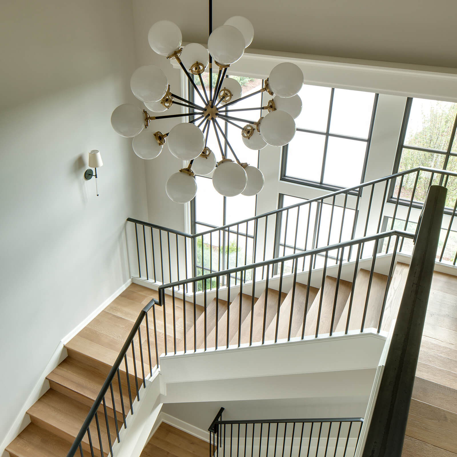 Interior stairwell view looking out to Marvin Signature Ultimate Casement Windows