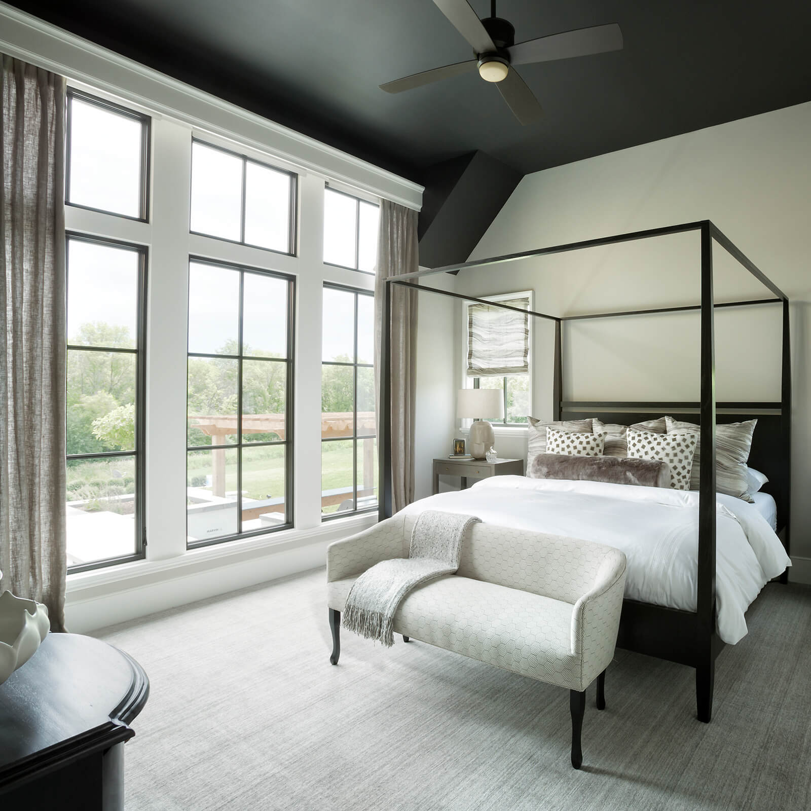 Large master bedroom with high ceilings and large Marvin Signature Ultimate Casement Windows