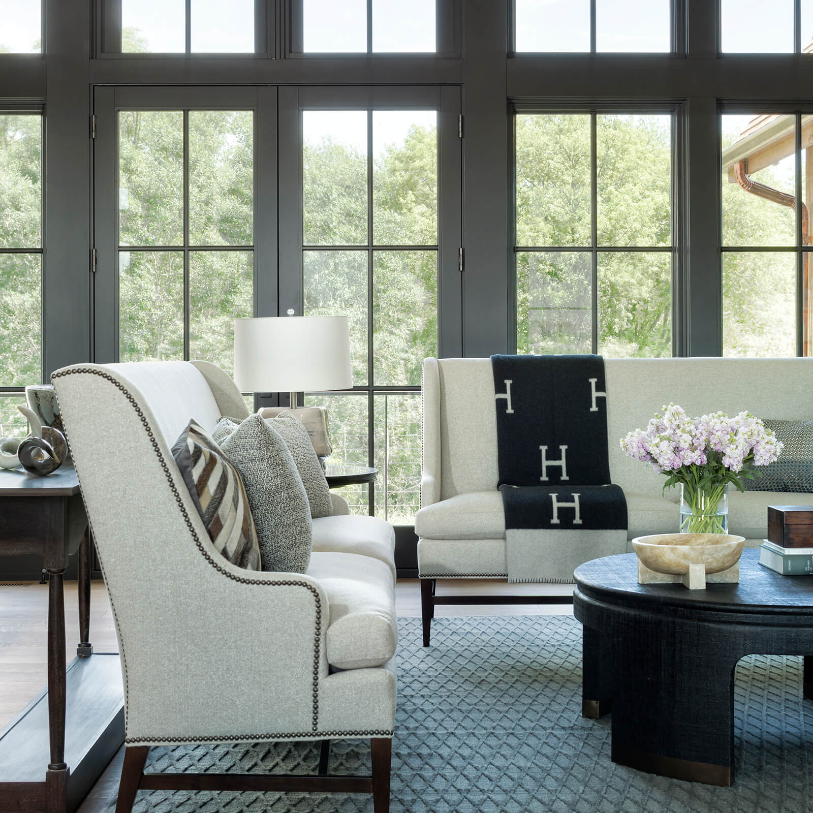Living room with Marvin Signature Ultimate Casement Windows and Ultimate Inswing French Door