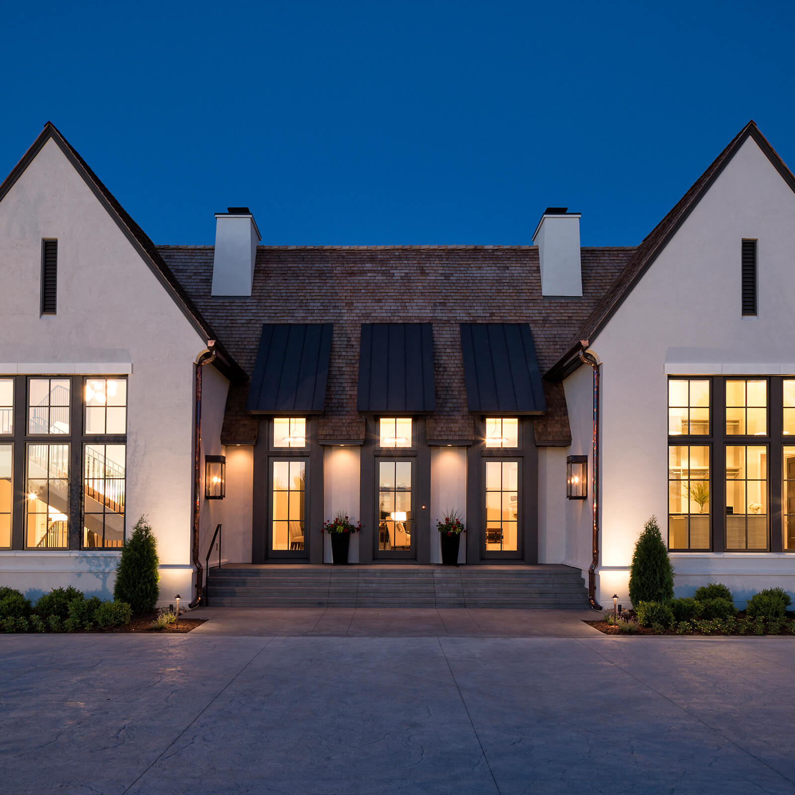 Modern style home with Marvin Signature Ultimate Inswing French Door and Ultimate Casement Windows