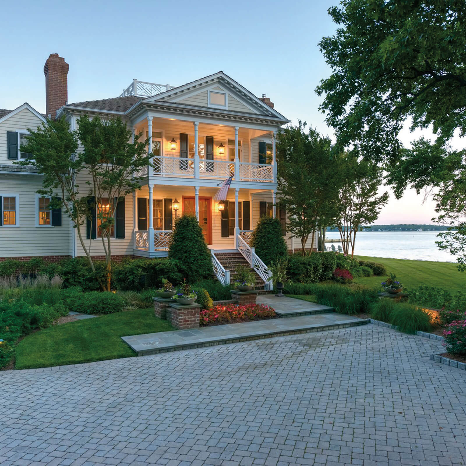 Large waterfront home with Marvin Elevate Double Hung Windows