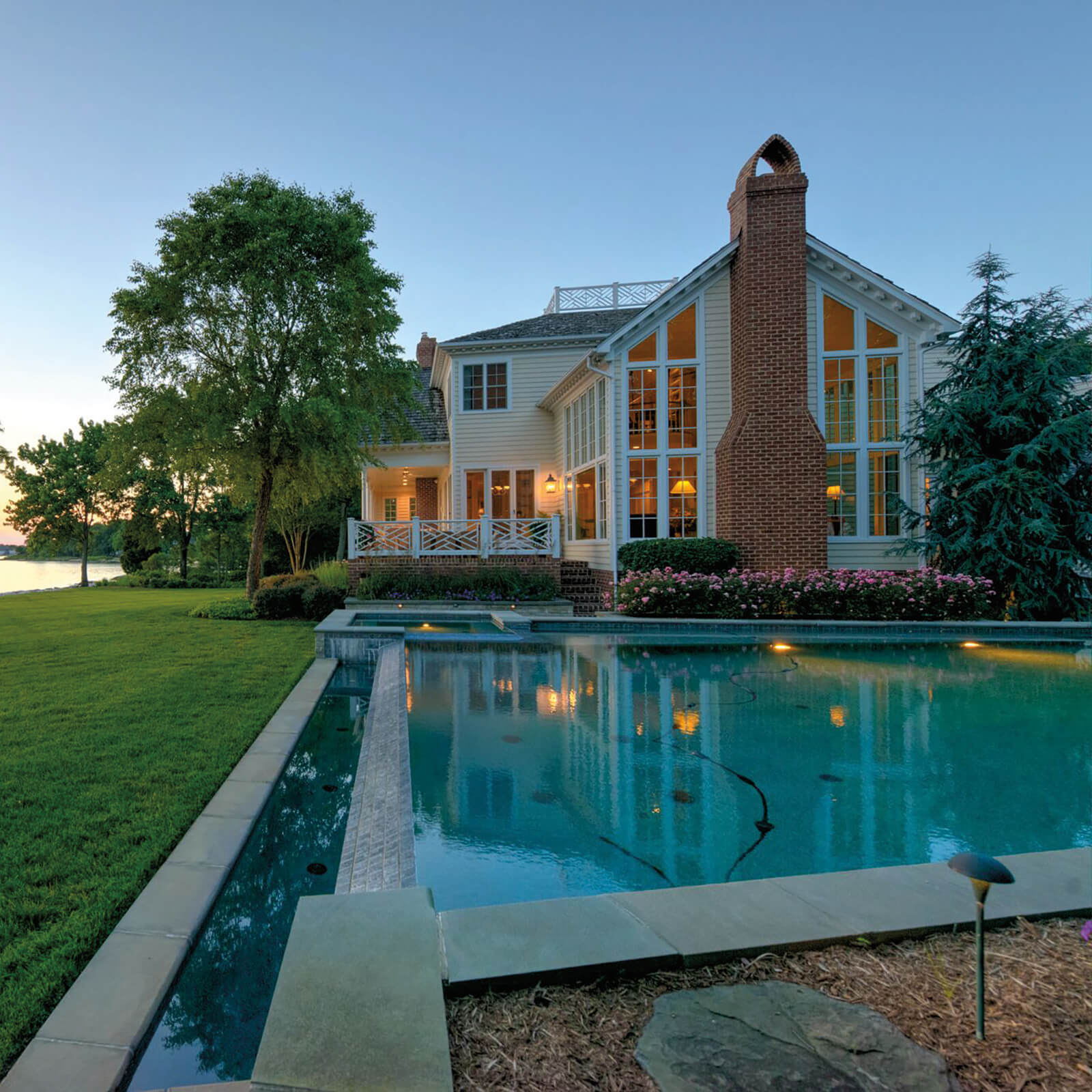 Poolside view of waterfront home with Marvin Elevate Inswing French Door