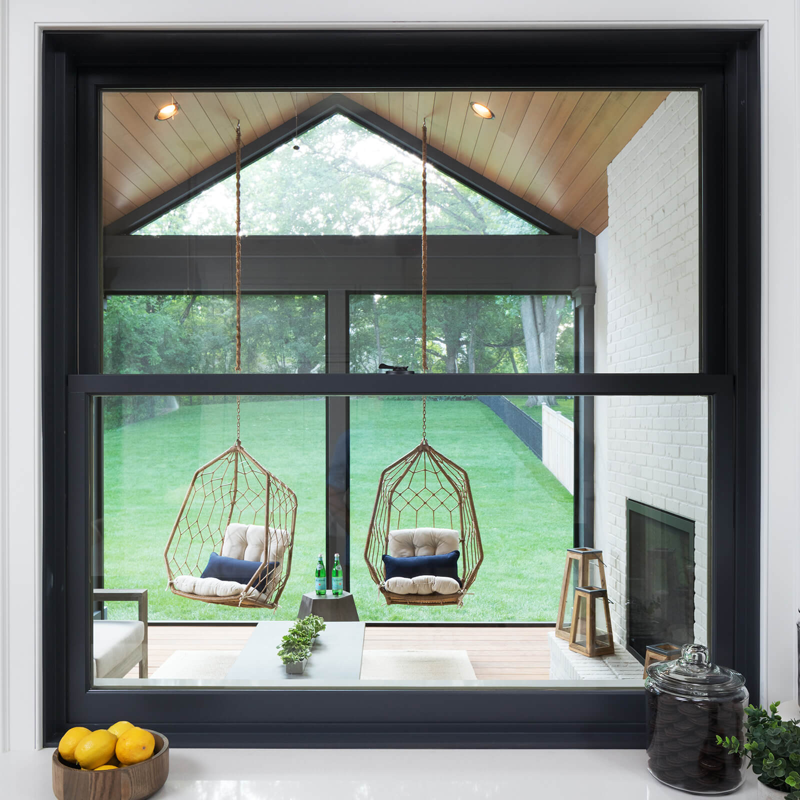 Interior view of outdoor patio through a Marvin Elevate Double Hung Window