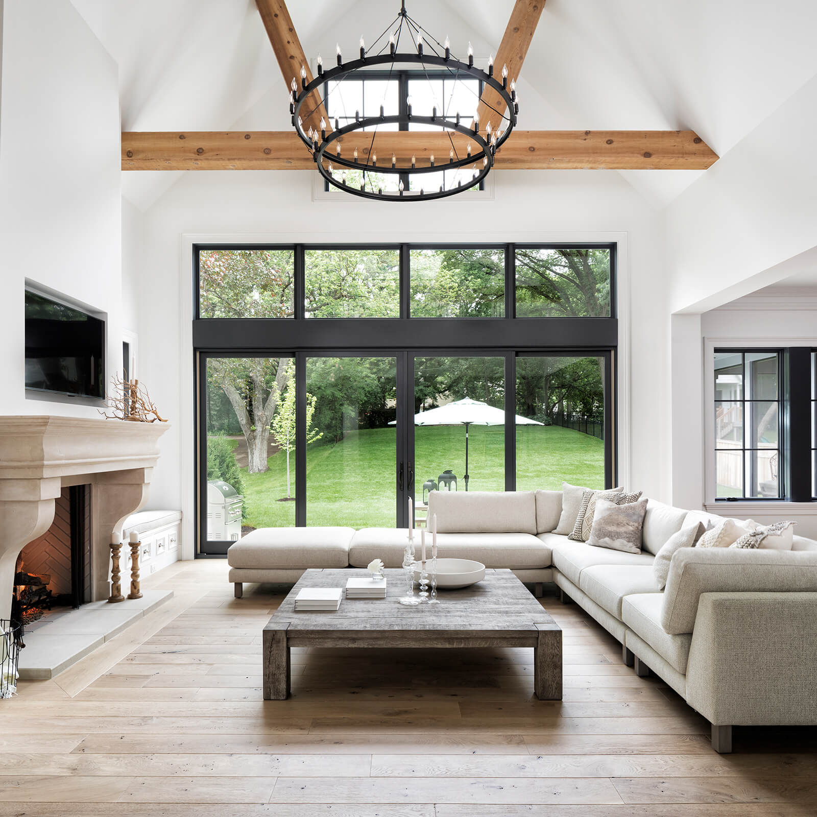 Living room with vaulted ceiling with large Marvin Elevate Sliding French Door