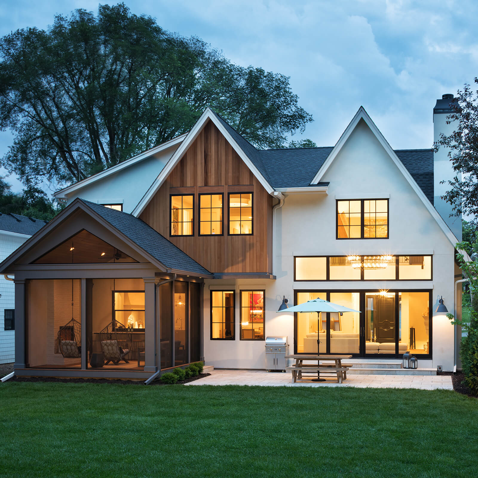 Exterior view of a modern traditional style home with Marvin Elevate Sliding French Door and Elevate Casement Windows