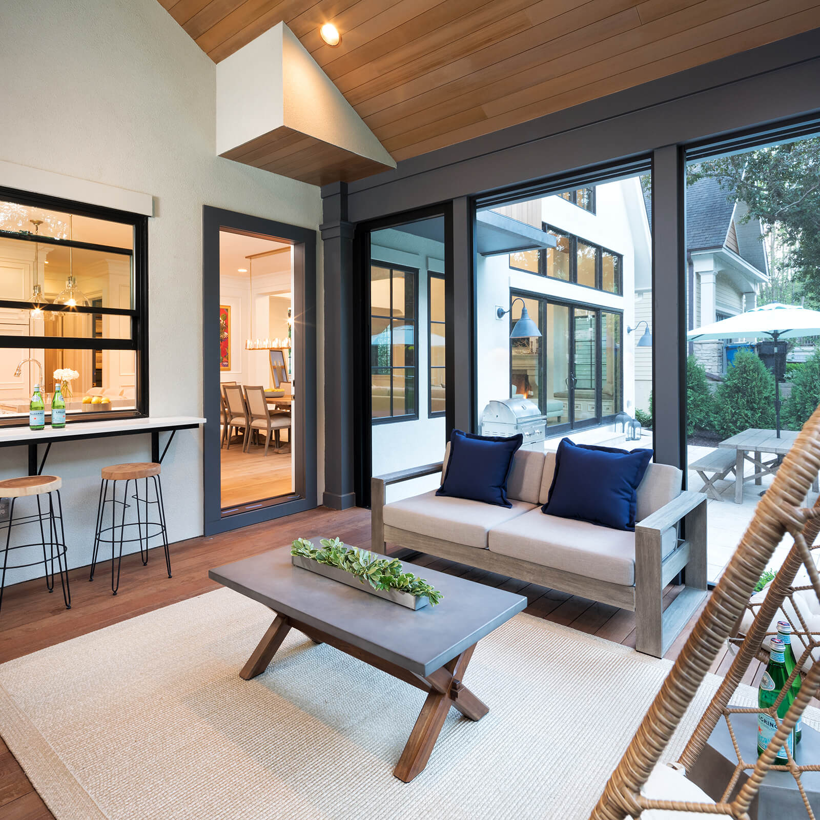 Large indoor outdoor living area with Marvin Elevate Sliding French Door and Elevate Casement Windows