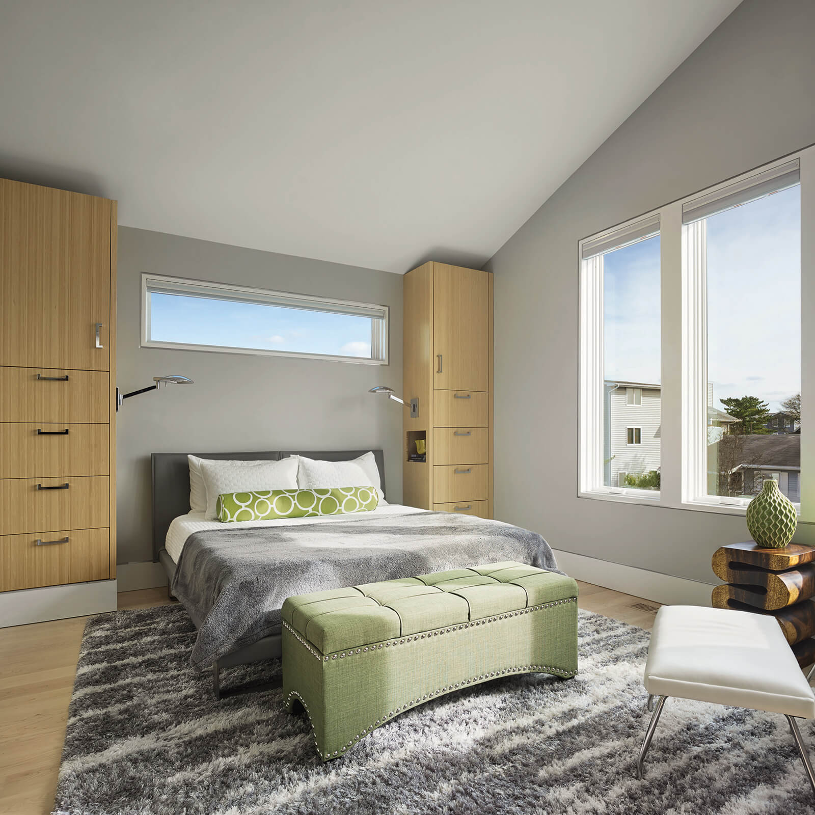 Contemporary style bedroom with floor to ceiling cabinets, modern furniture and Marvin Elevate Casement Windows