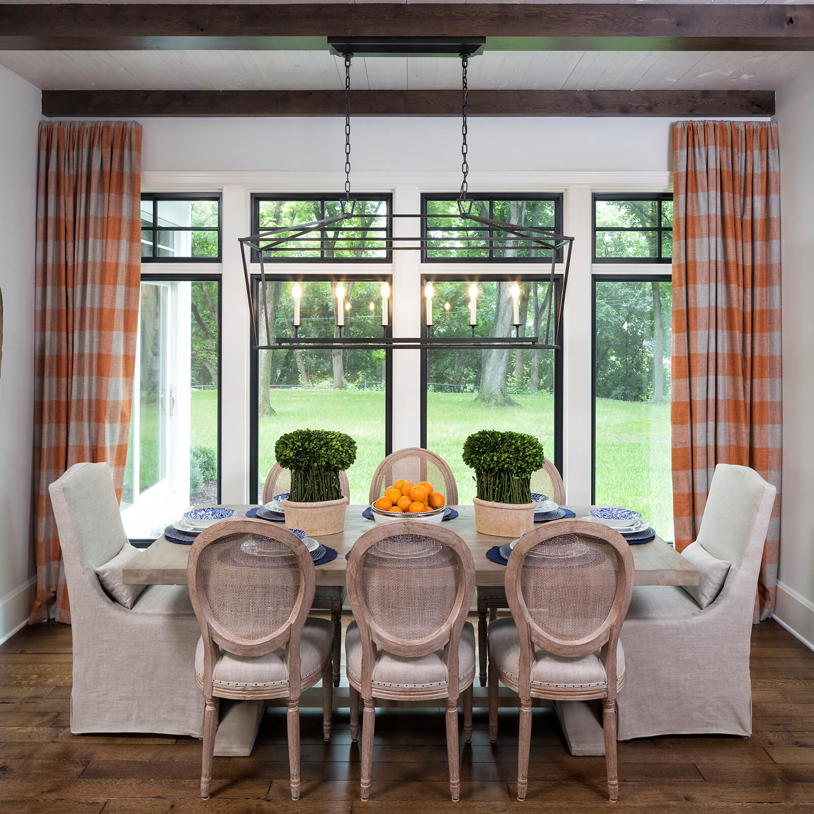 Dining room with Marvin Signature Ultimate Casement Windows
