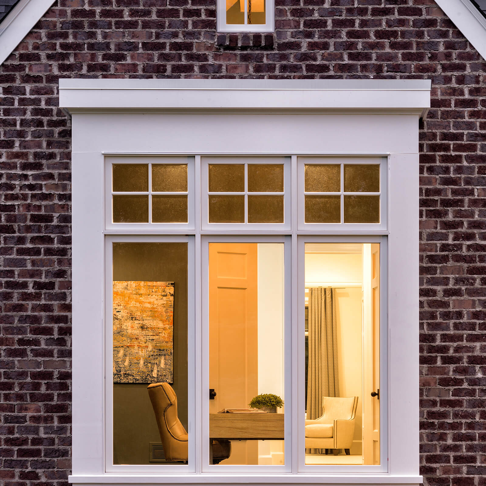 Exterior brick facade home with Marvin Signature Ultimate Casement Window