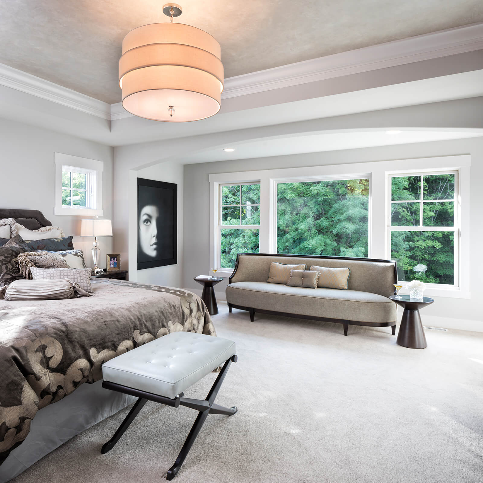 Large bedroom with Marvin Elevate Awning Windows, Elevate Double Hung Windows and Elevate Picture Windows