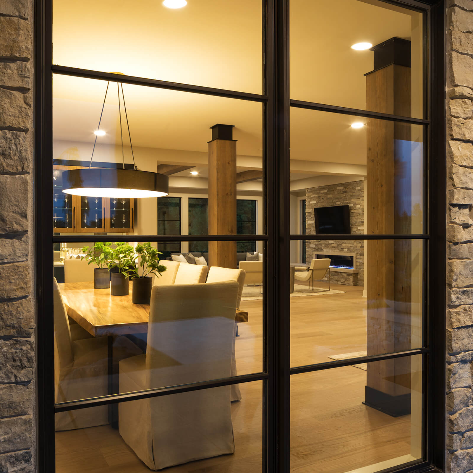 Closeup view into open concept living area through a Marvin Elevate Casement Window