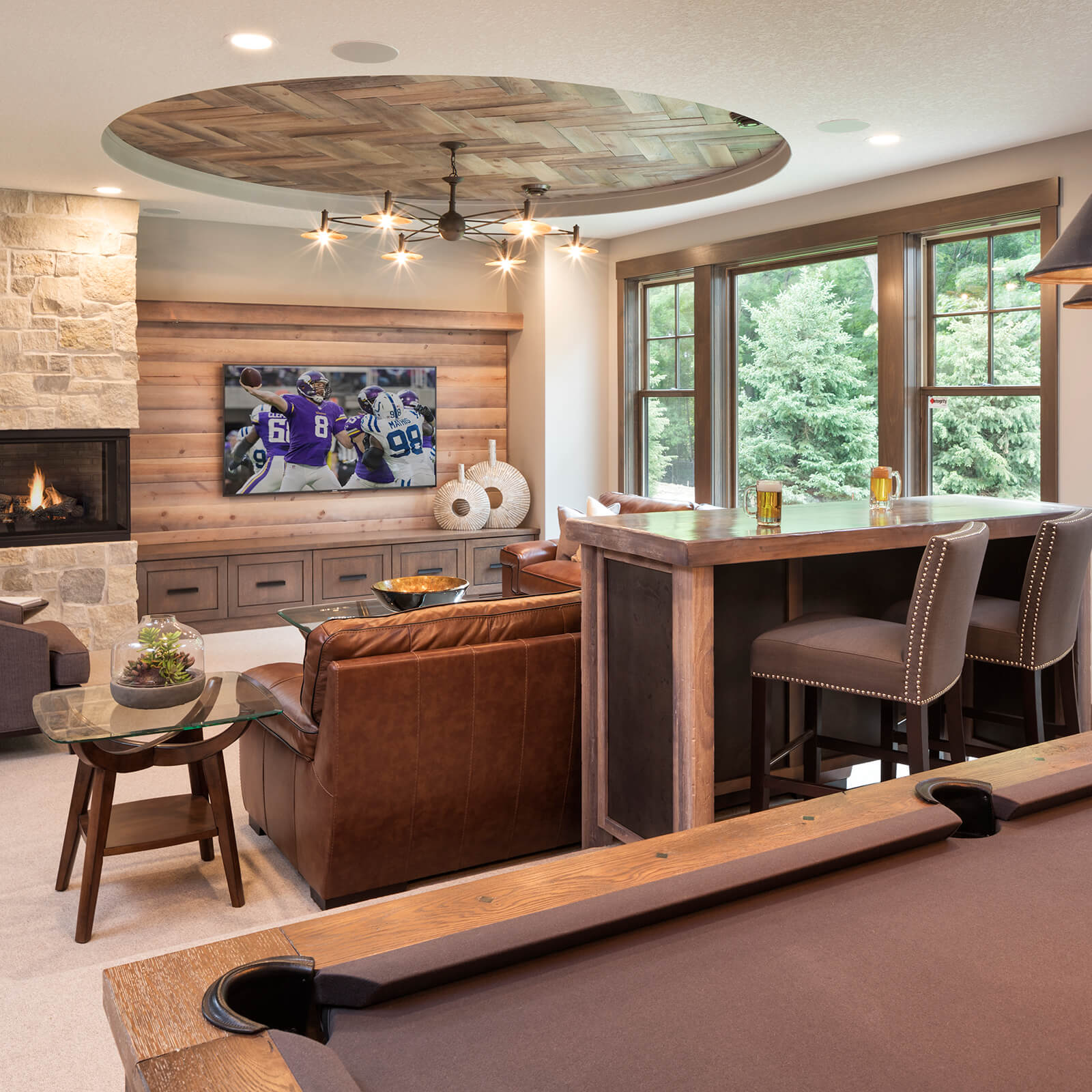 Entertainment room with Marvin Elevate Double Hung Windows and Elevate Picture Windows
