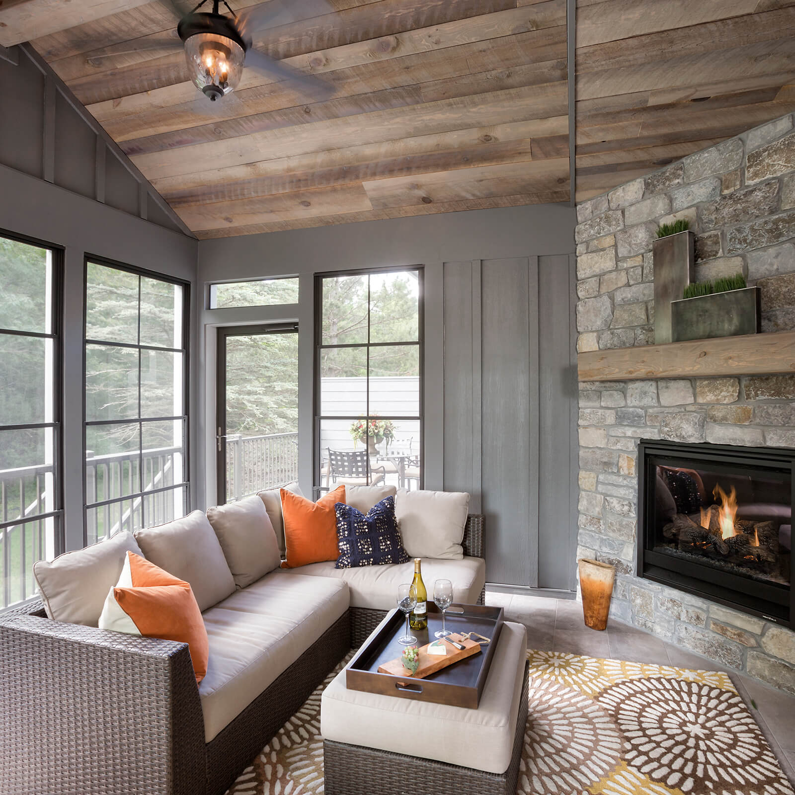 Rustic three season porch with Marvin Elevate Outswing French Door