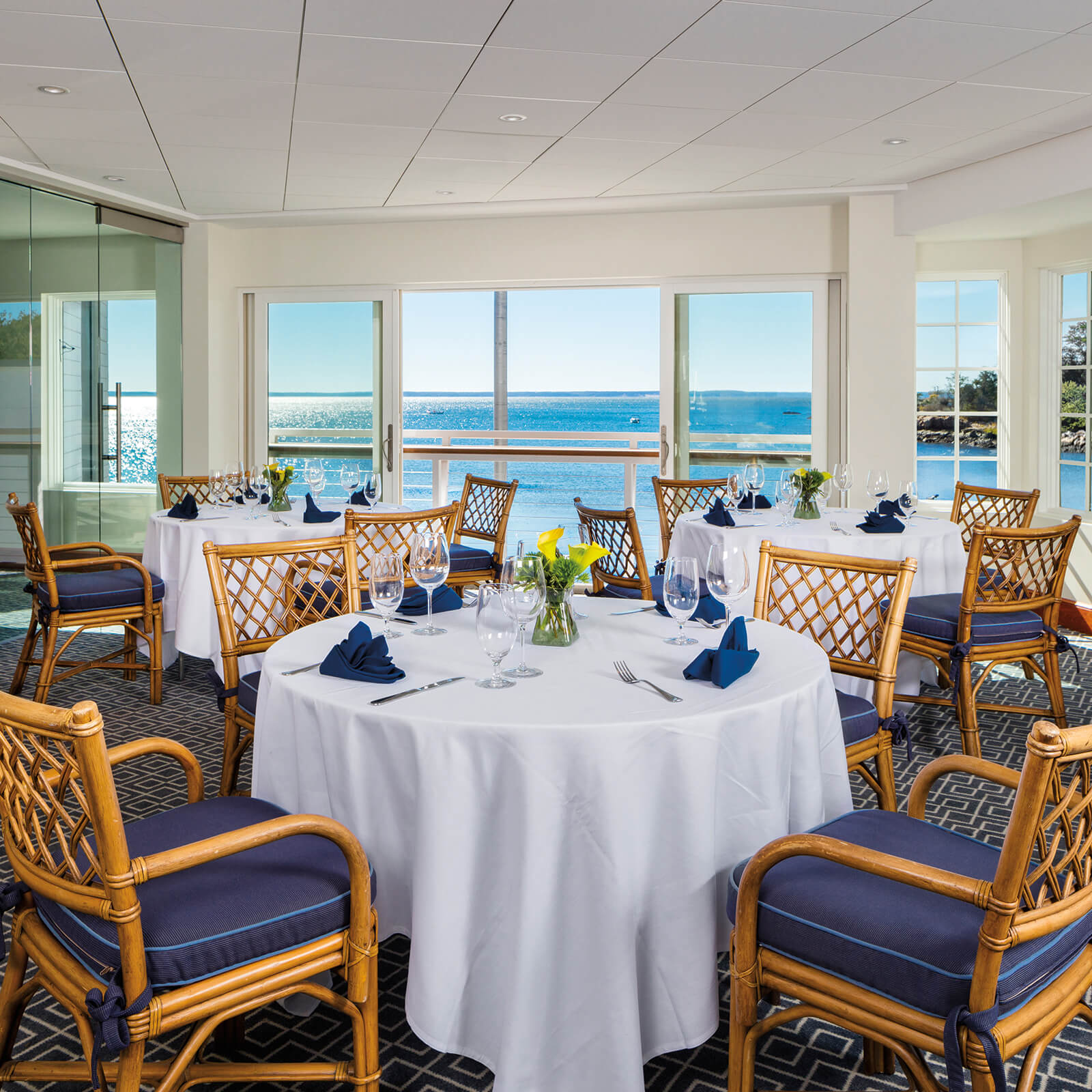 Dinning room of Traditional style commercial beach side building with Marvin Elevate Sliding French Door and Elevate Casement Windows