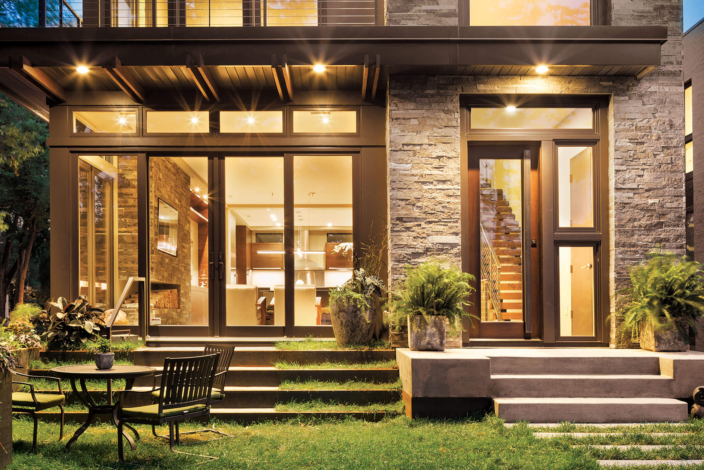 Beautiful Exterior View of Lake House With Marvin Elevate Sliding French Door