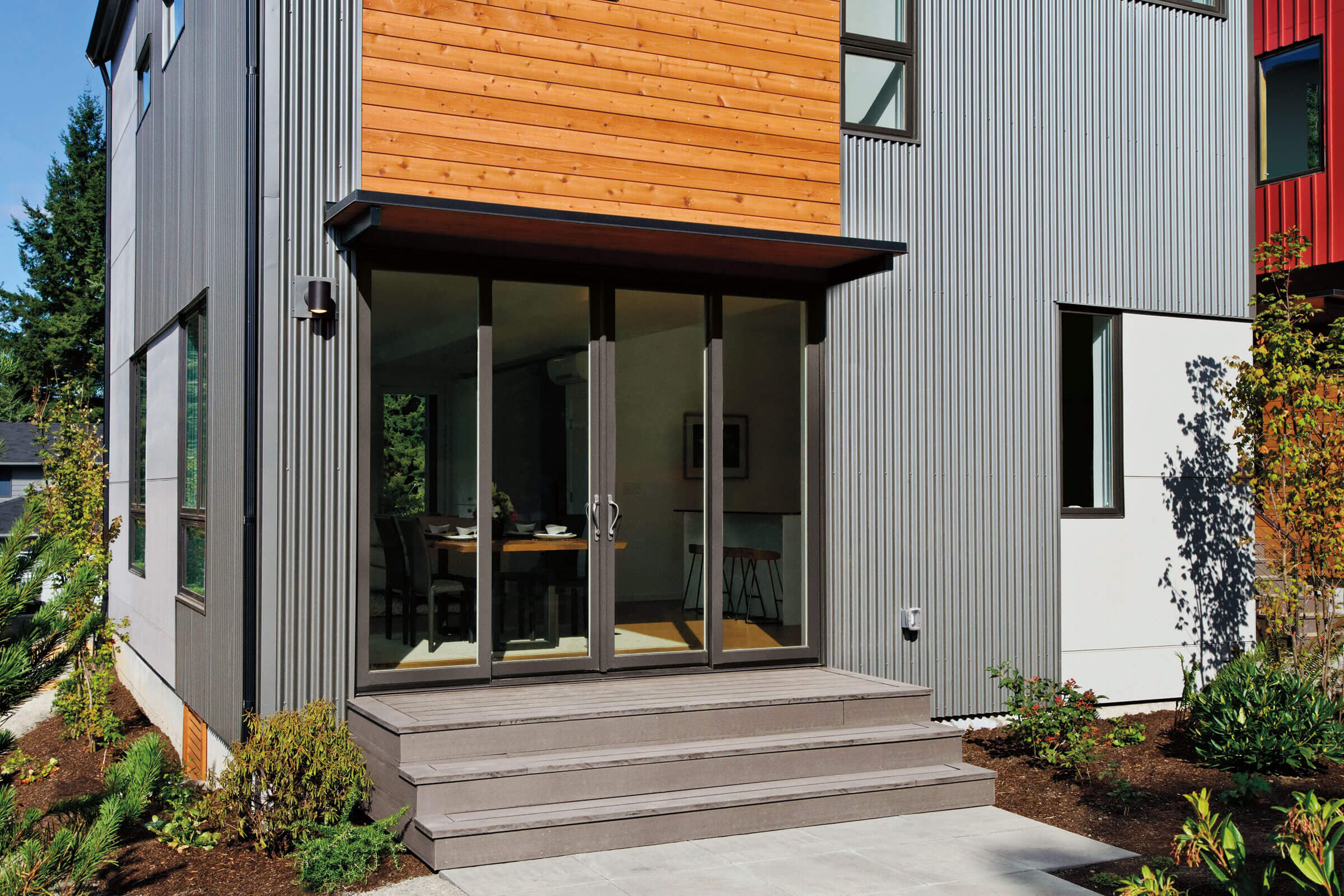 Stairs To Entrance Of Gray House With Marvin Elevate Sliding Patio Door