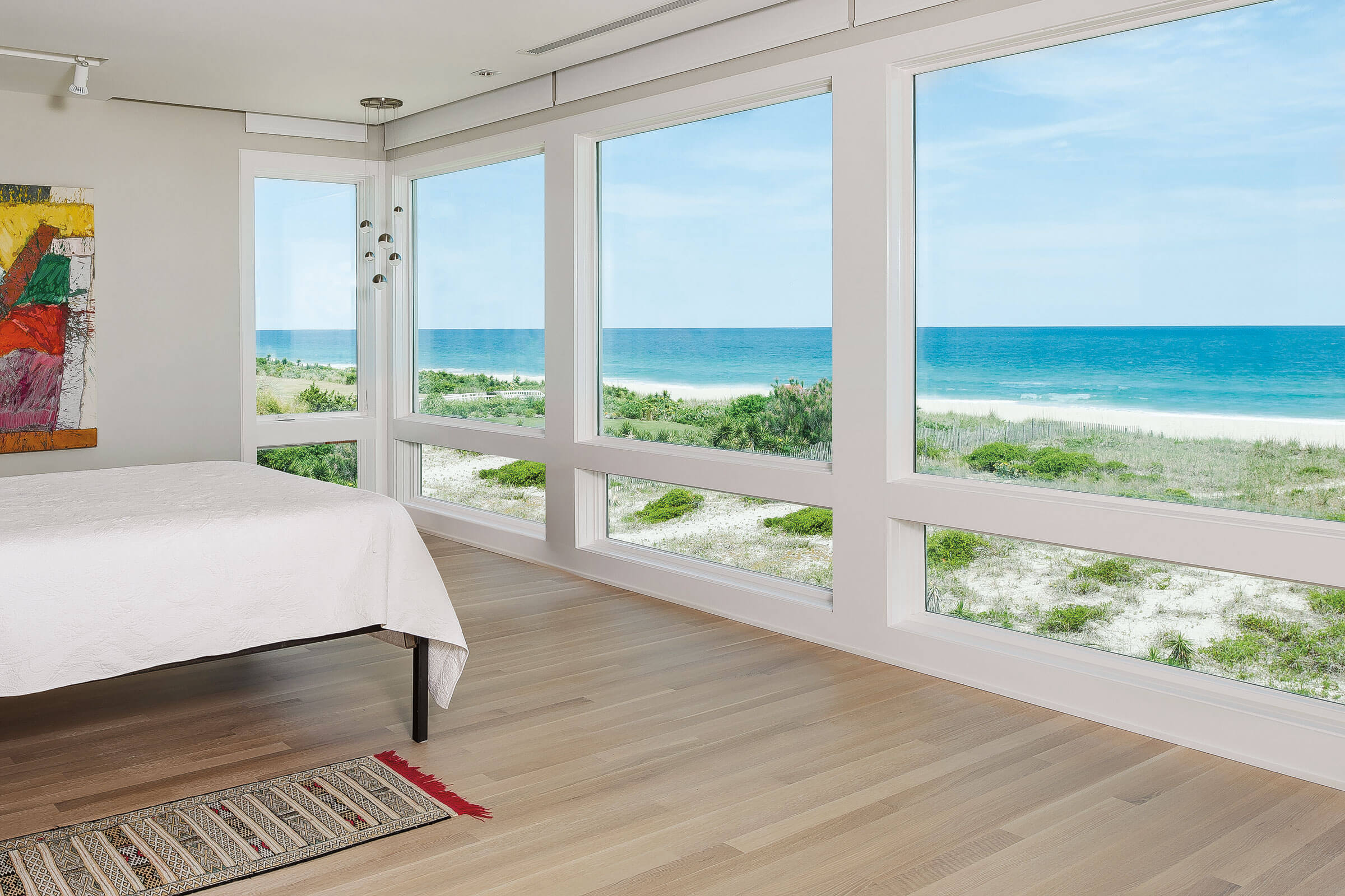 Bedroom With Beautiful Beach View Through Marvin Elevate Picture Windows