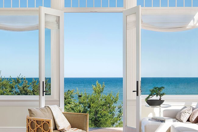 Beautiful Ocean View From Living Room With Signature Ultimate Swinging French Doors