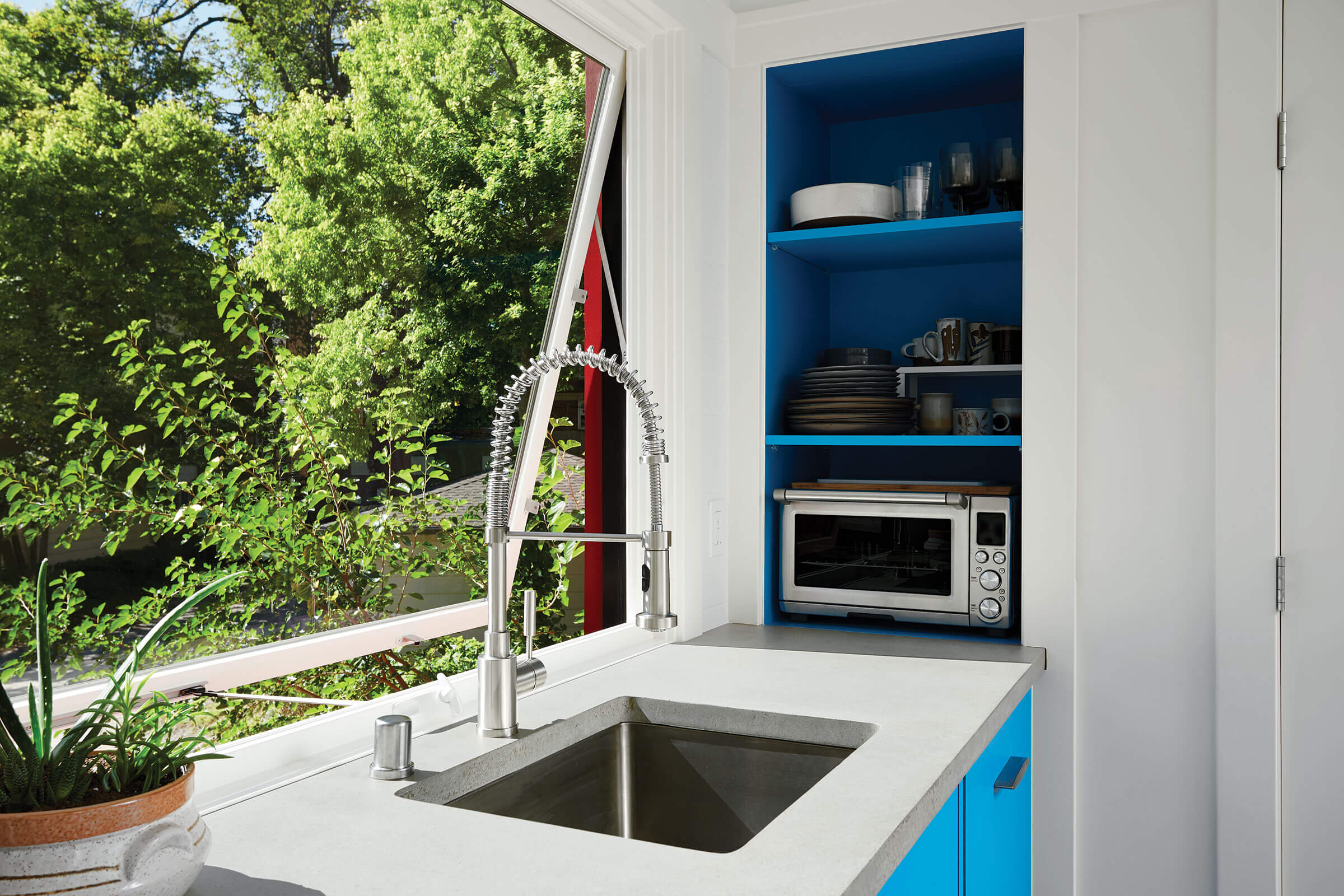 Kitchen With Large Signature Ultimate Awning Window Above Sink
