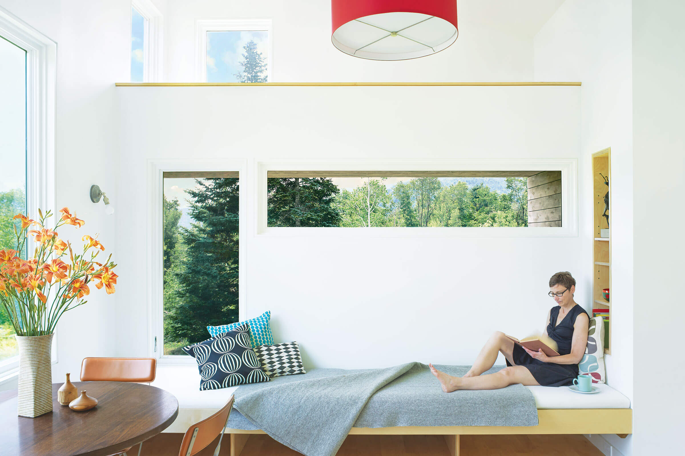 Woman Reading In Living Room With Signature Ultimate Casement Window