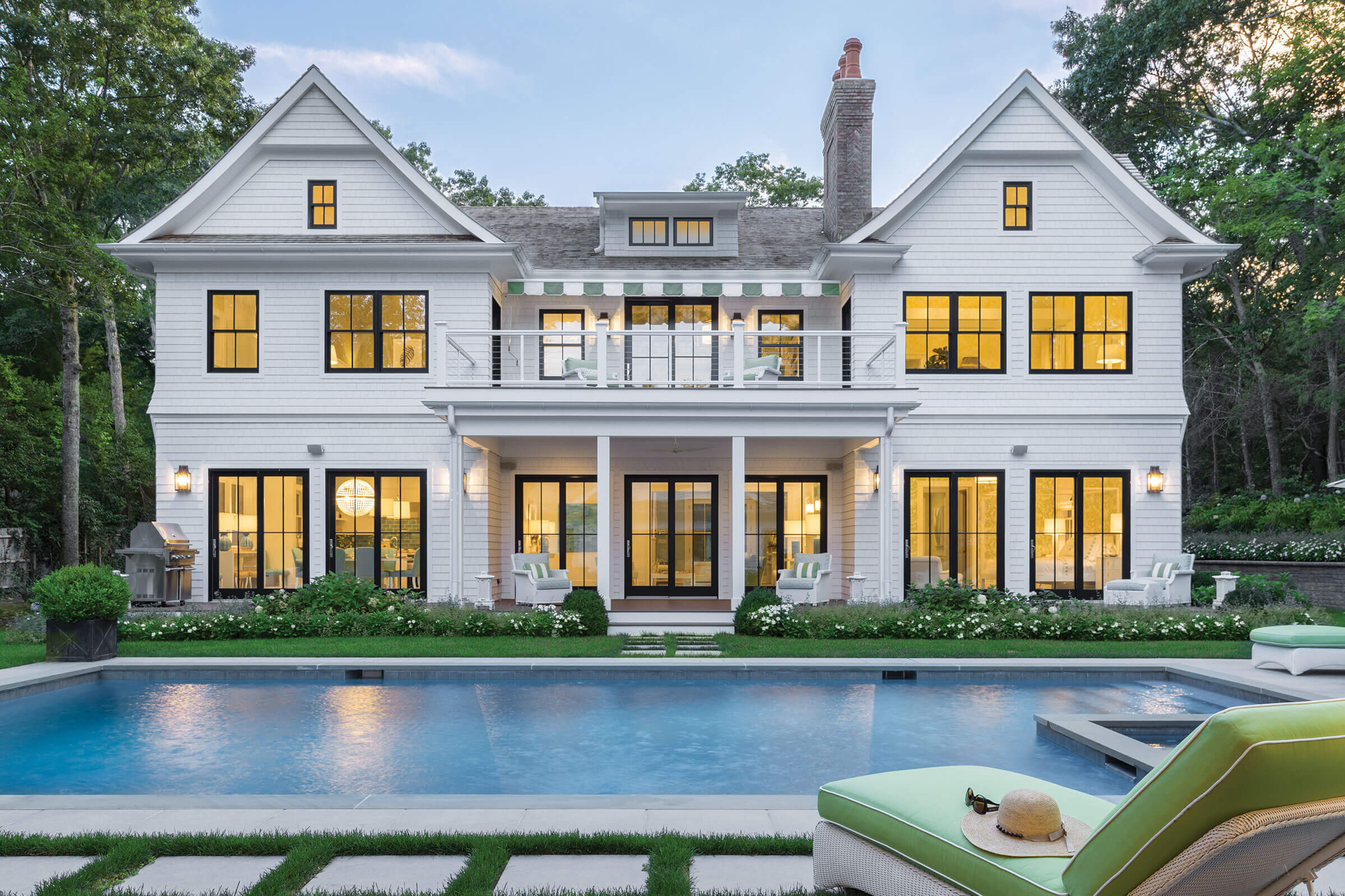 Pool And Exterior View of Large White House With Signature Ultimate Double Hung G2 Windows