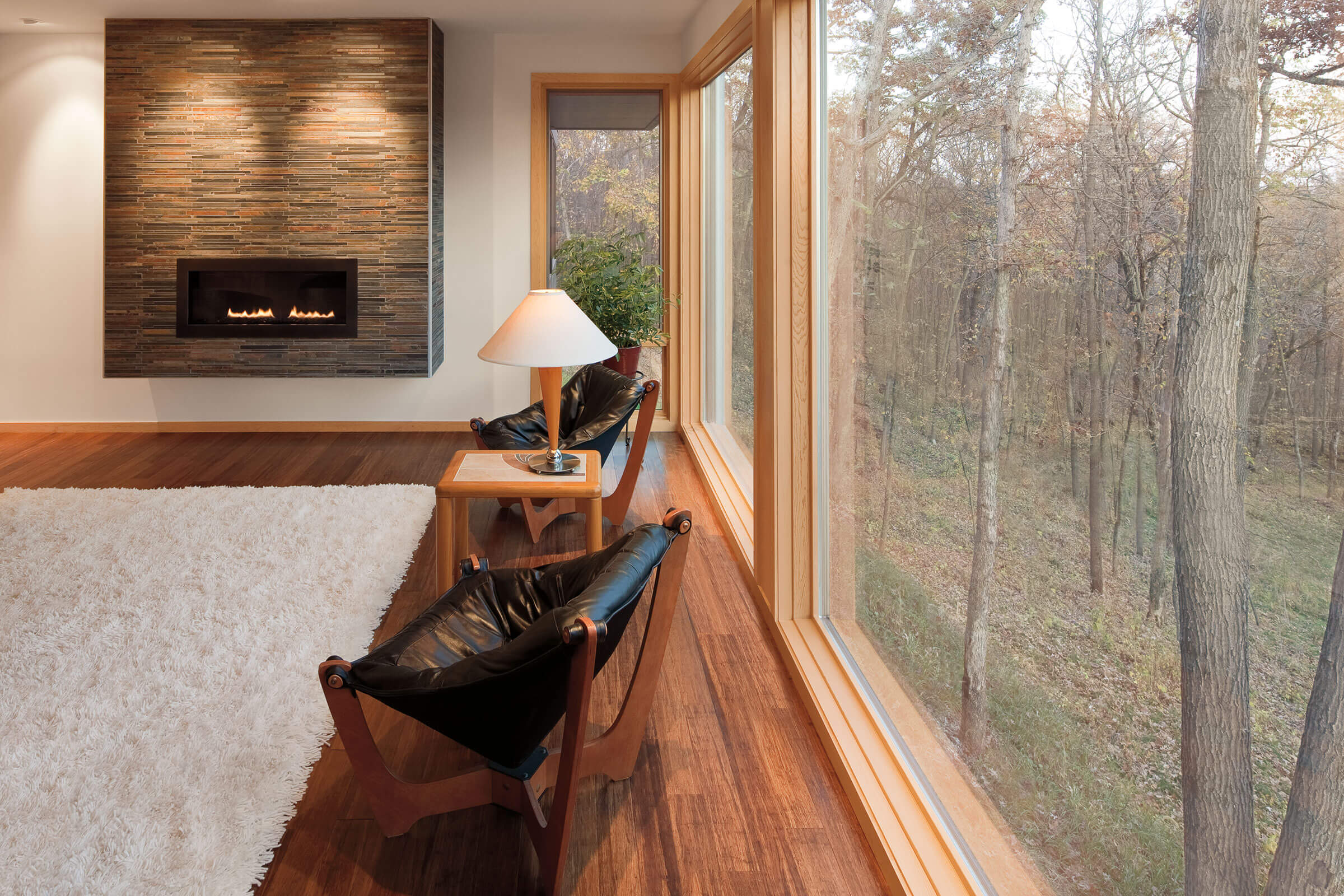 Living Room With View Of Trees Through Signature Ultimate Picture Window