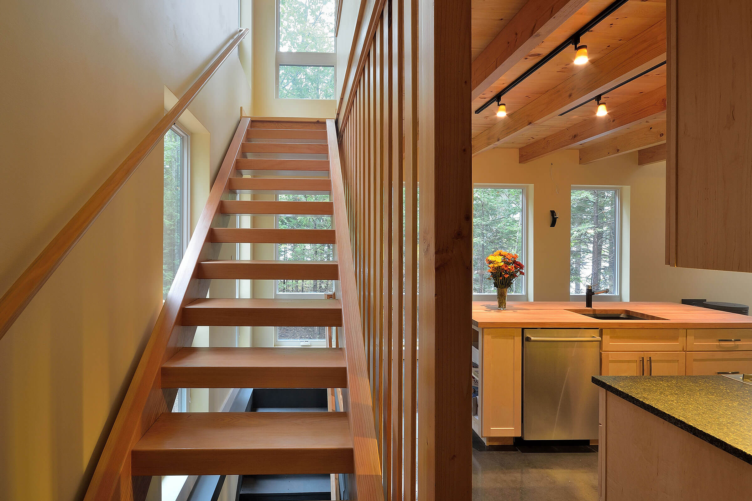 Staircase And Kitchen In Contemporary Cabin With Marvin Essential Windows