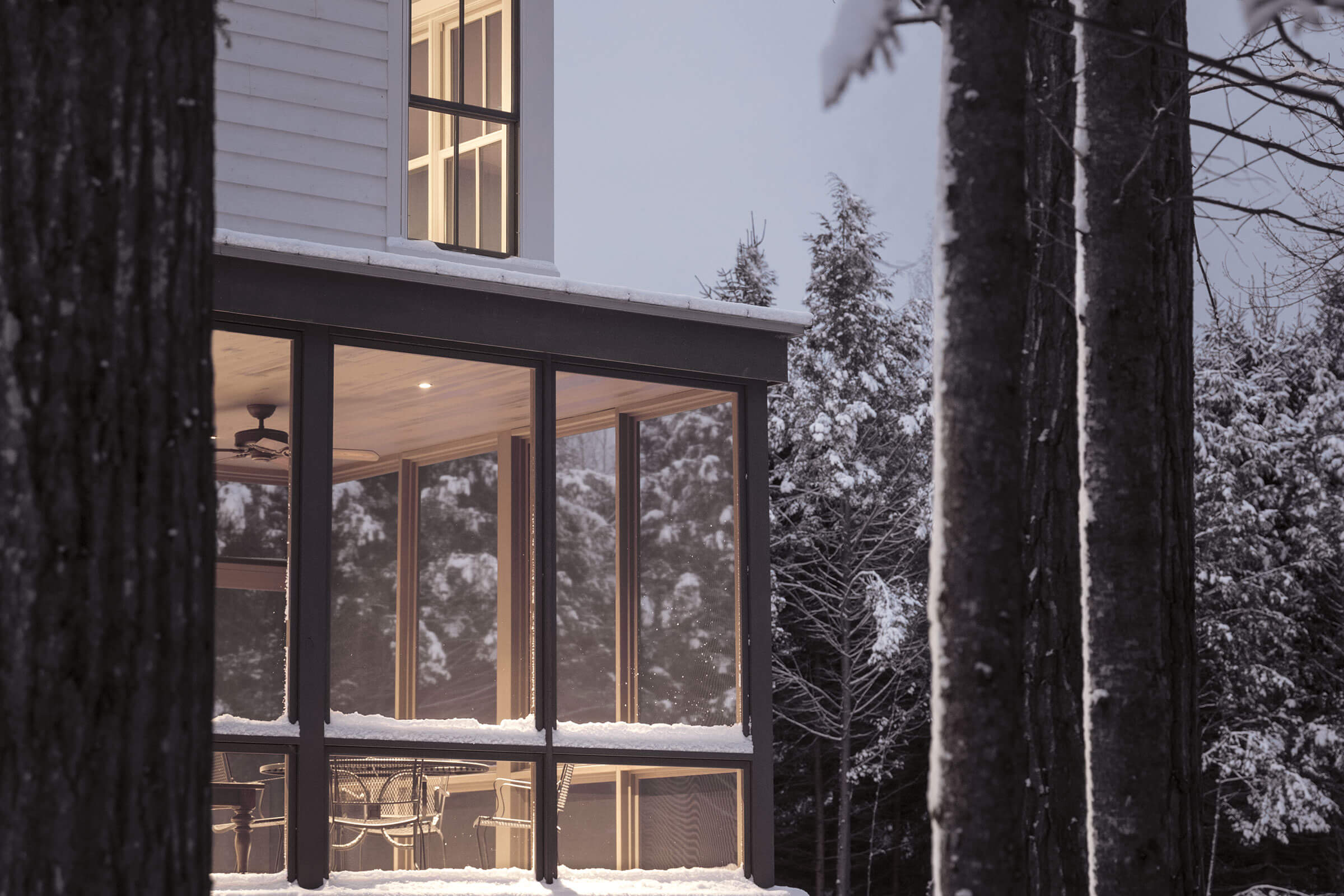 Snowy Scene Of Home With Elevate Windows And Doors