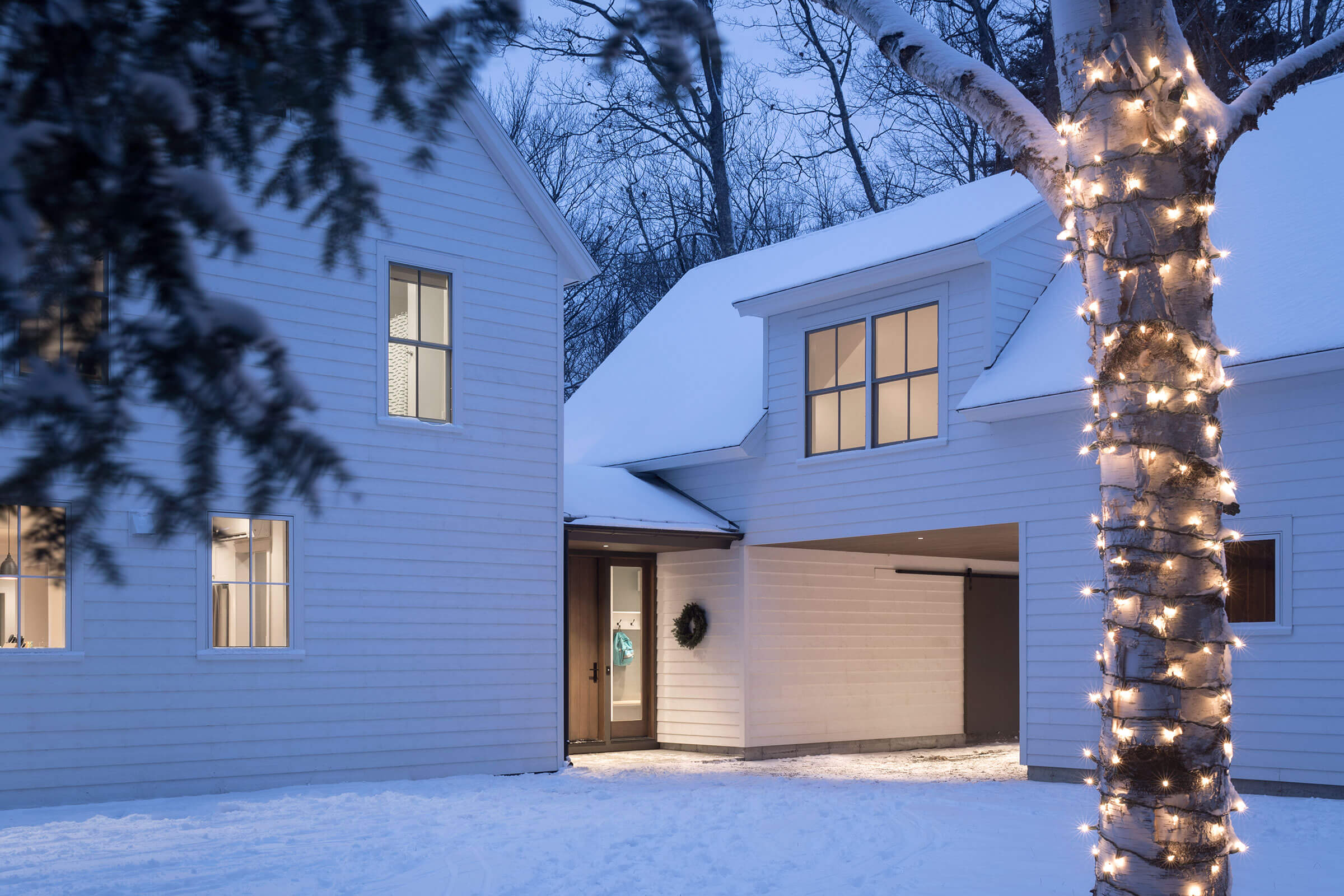 Beautiful Snowy Scene Of Home With Elevate Windows And Doors