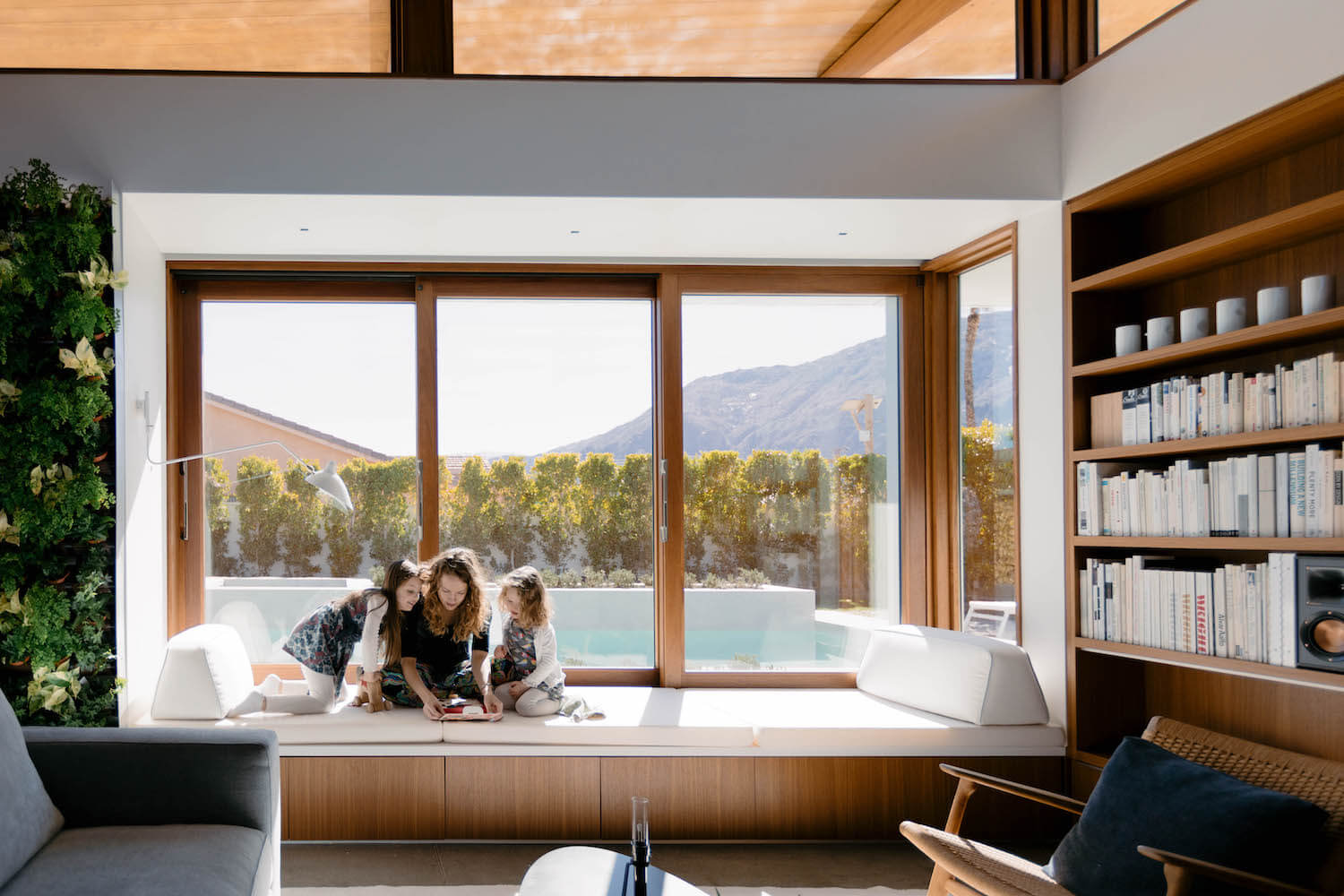 Meelena Turkel and her daughters on the window seat in Axiom Desert House.