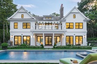 Pool And Exterior View Of Large White House With Signature Ultimate Double Hung Windows