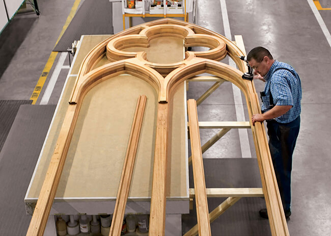 Man Working On Historic Design Custom Marvin Window in Factory