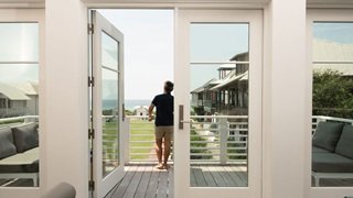 Vern Yip On Balcony Of Coastal Home With Marvin Windows And Doors