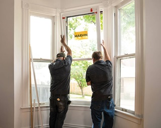 2 Men installing Double Hung Marvin Windows