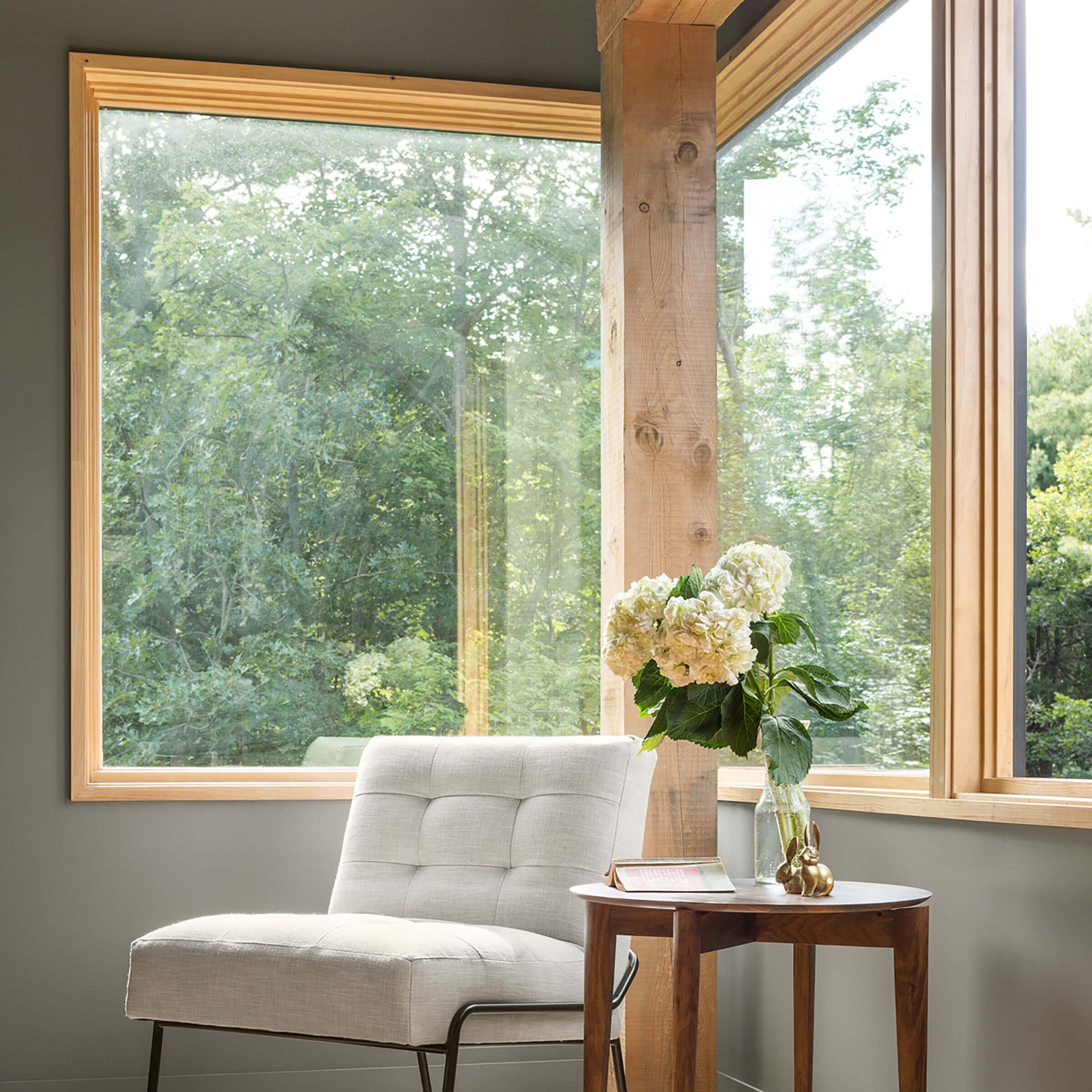 Cozy Sitting Area In Front Of Essential Casement Window