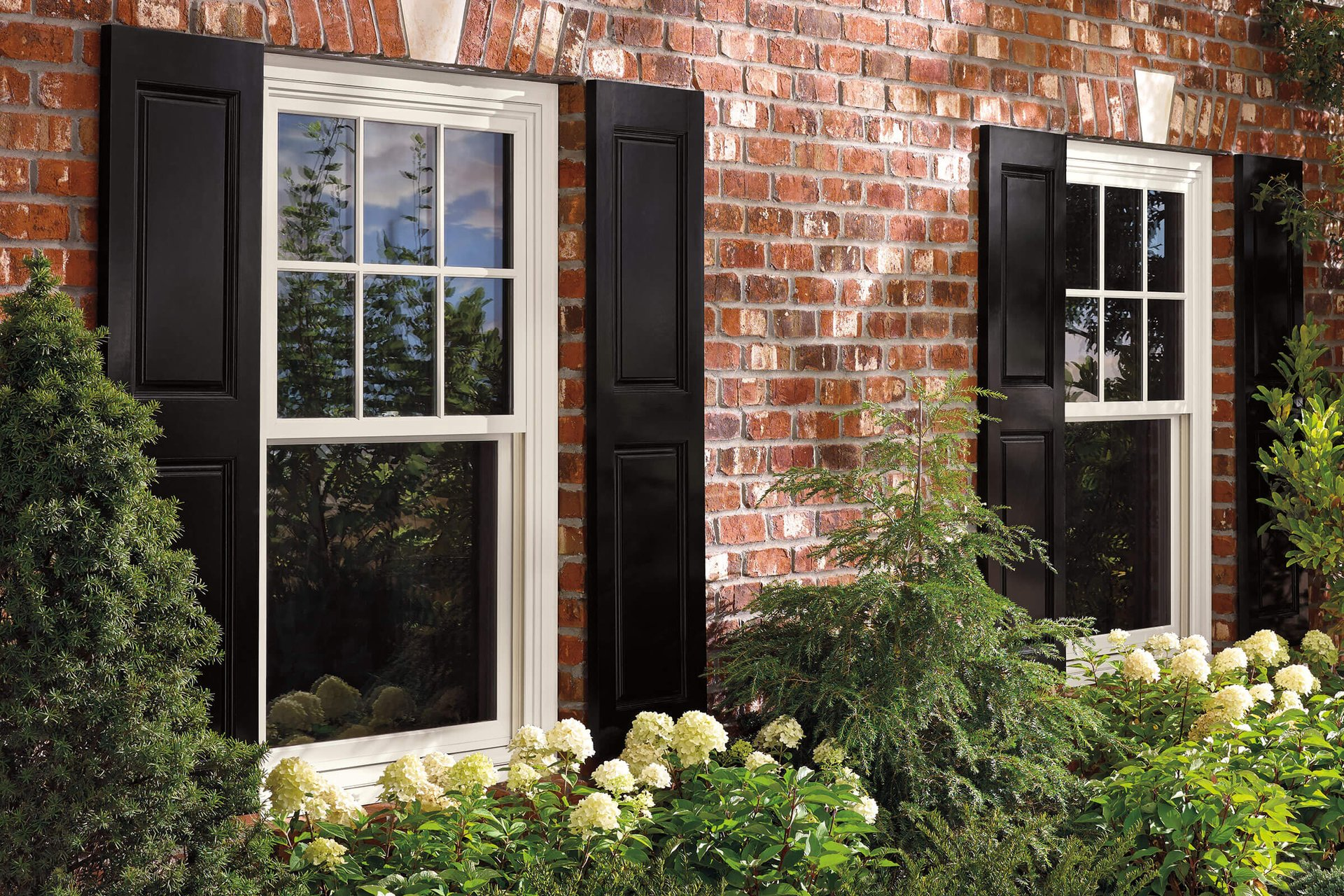 Brick Exterior View Of House With Marvin Elevate Double Hung Insert Windows