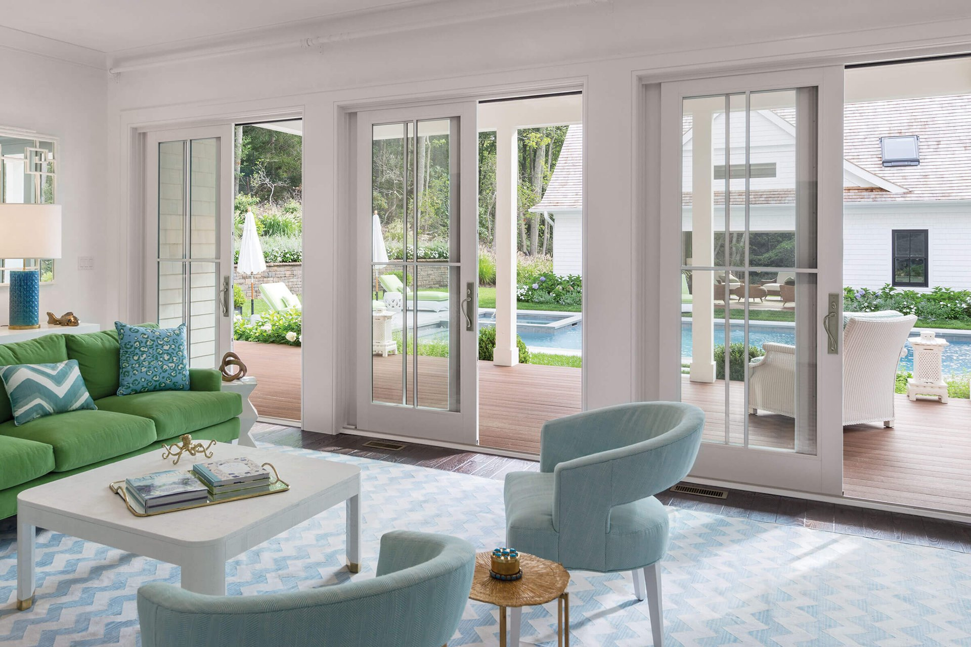 Green And Blue Living Room With Open Signature Ultimate Sliding French Doors